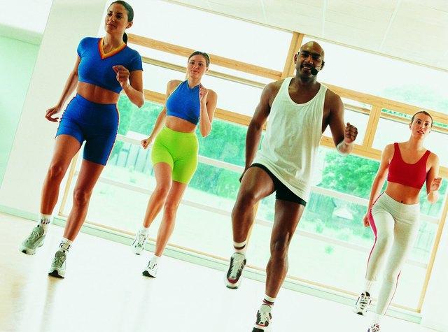 Men and women in aerobics class