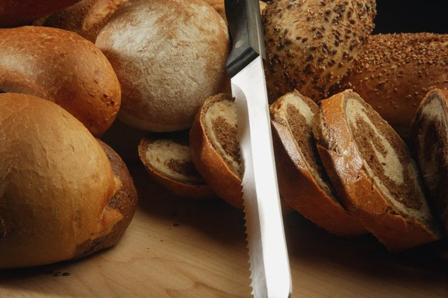 A selection of breads and a bread knife