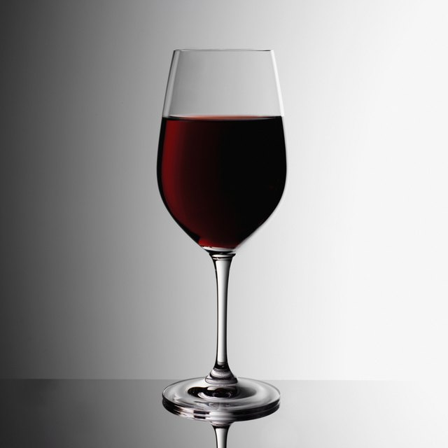 Glass of red wine indoors