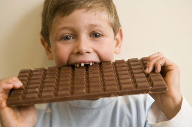 Boy eating large chocolate bar