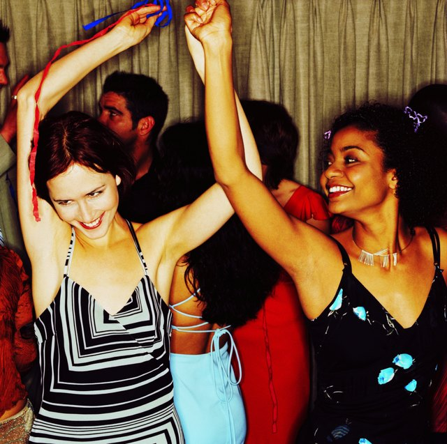 view of two young women dancing at a party