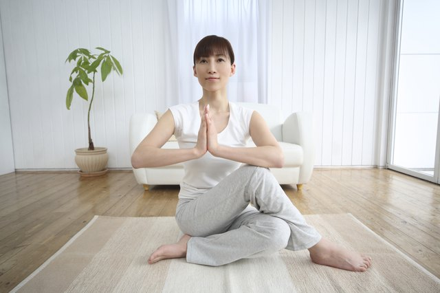 Young Woman Practicing Yoga, Stretching Arms and Legs, Front View