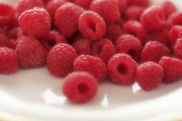 Fresh raspberries on plate