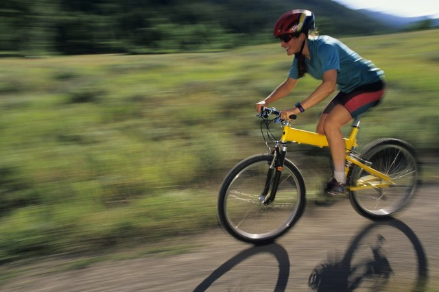 Female mountain biker riding on trail in park