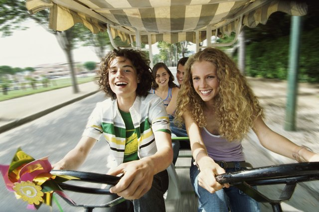 Teenage Boys and Girls Cycling With Their Friends in a Rickshaw