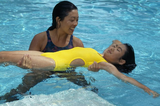 asian mother and daughter swimming