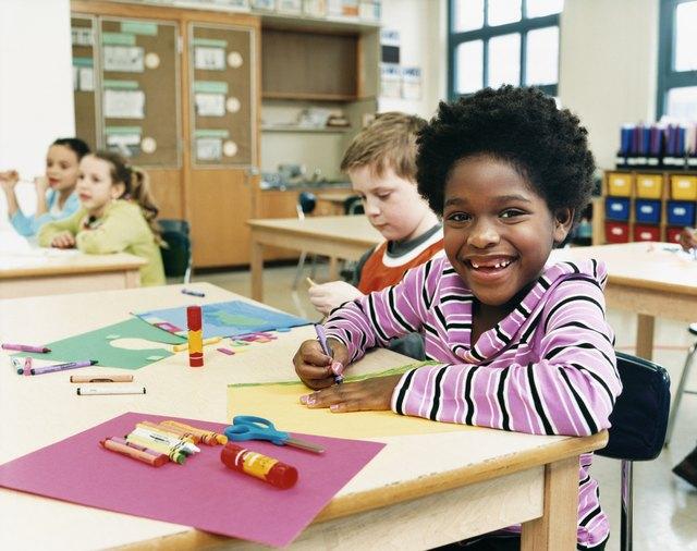 Primary School Children Sitting at Their Desks Colouring-In