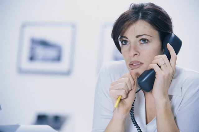 Nervous woman on telephone