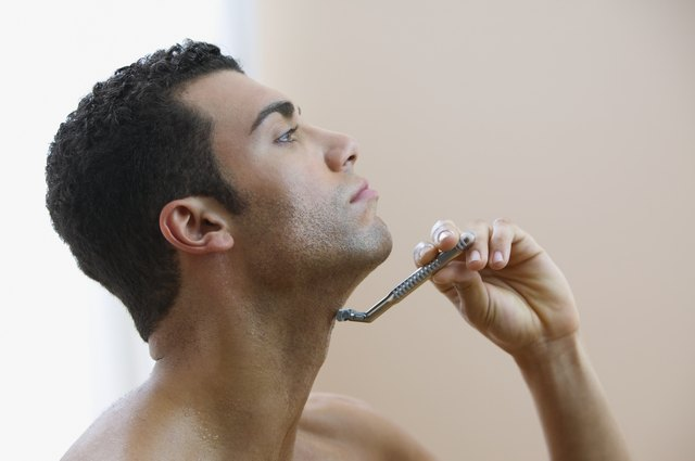 Profile of man shaving