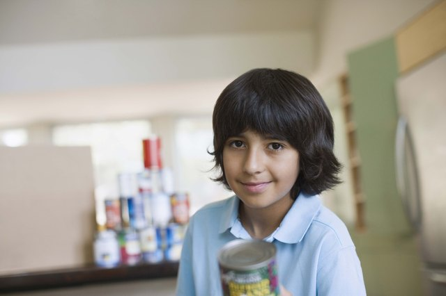 Boy holding canned food for food drive