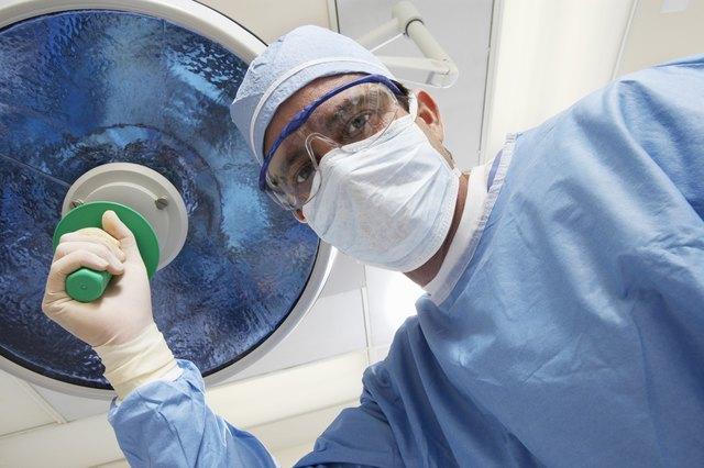 Surgeon adjusting lamp, low angle view