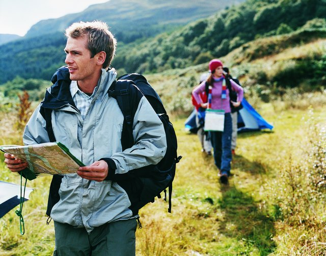 Two Young Adults Leave Their Tent to go Orienteering