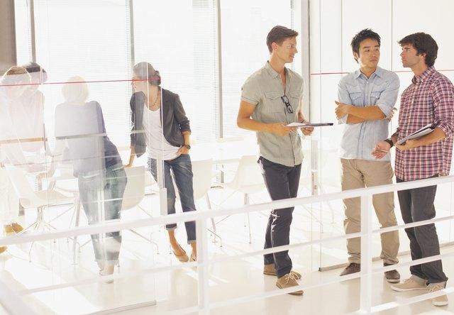 Businessmen meeting in doorway conference room