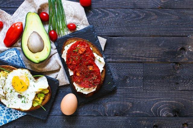 Delicious Tasty Avocado Eggs and Tomato Cheese Toasts