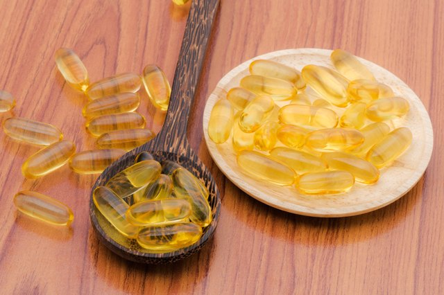 Fish oil omega3 with wooden spoon