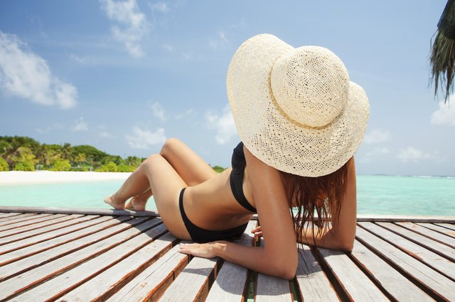 Young fashion woman relaxing on the beach