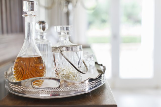 Crystal alcohol decanters on silver tray