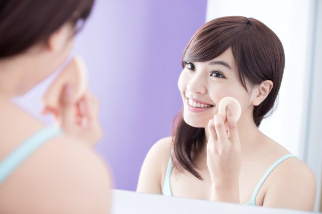 Smile woman with cosmetic sponge