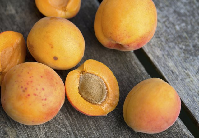 apricots on wooden background