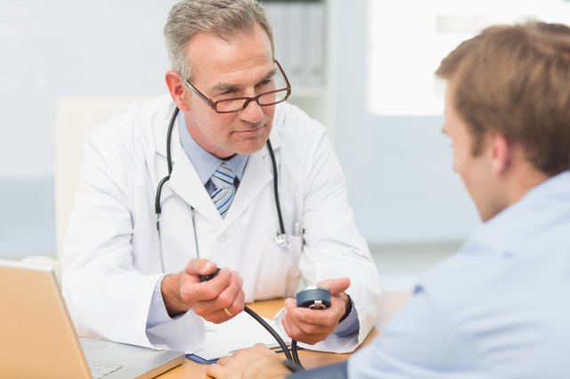Doctor taking his patients blood pressure