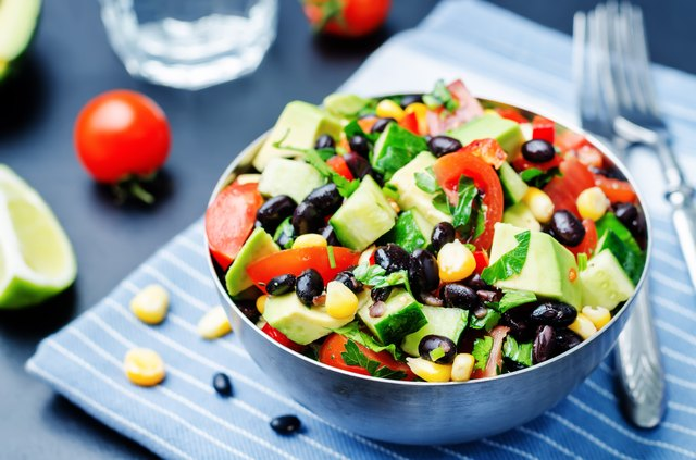 Black beans corn avocado cucumber tomato salad with lime dressing