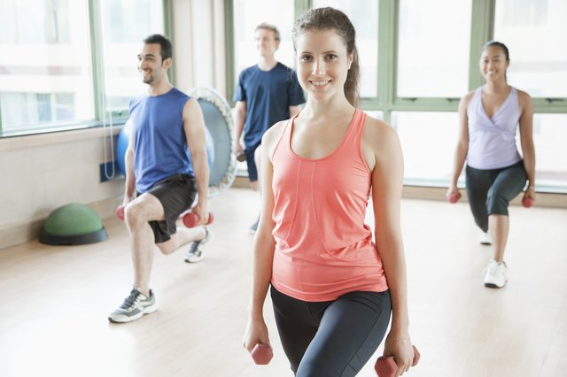 Four people stretching in aerobics class