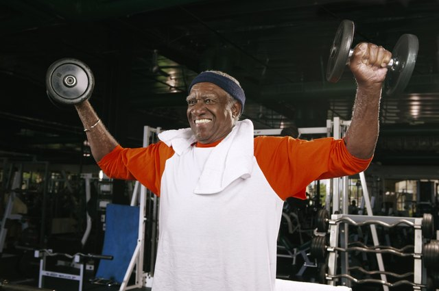 Senior man weight training in gym