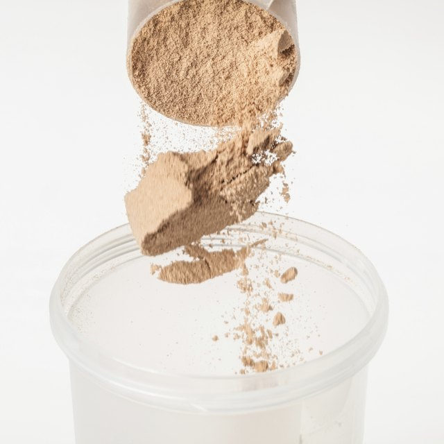Chocolate whey isolate protein tossed into plastic shaker
