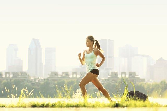 Running woman city fitness