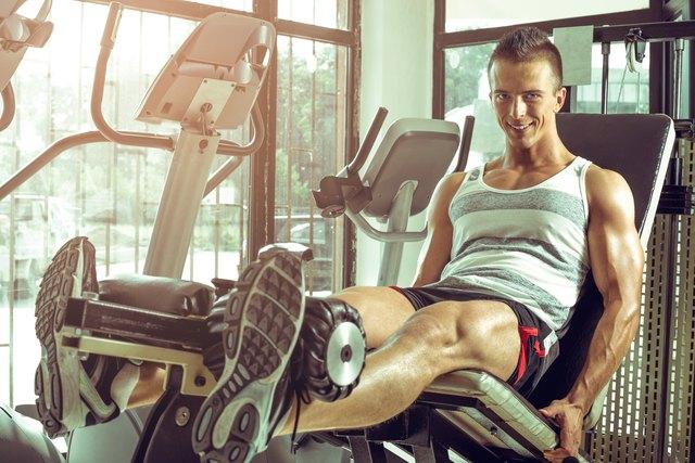 Man doing leg extension in gym