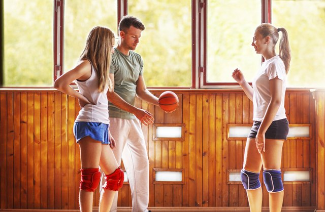 Coach and students in training volleyball