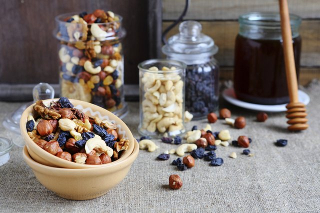 mix nuts in a bowl on the table and jar