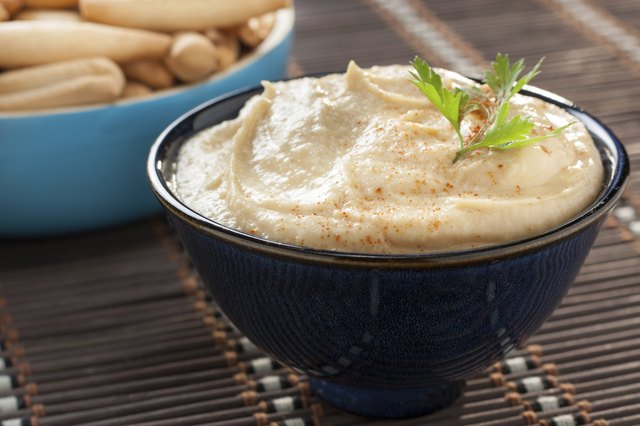 bowl of homemade hummus with breadsticks