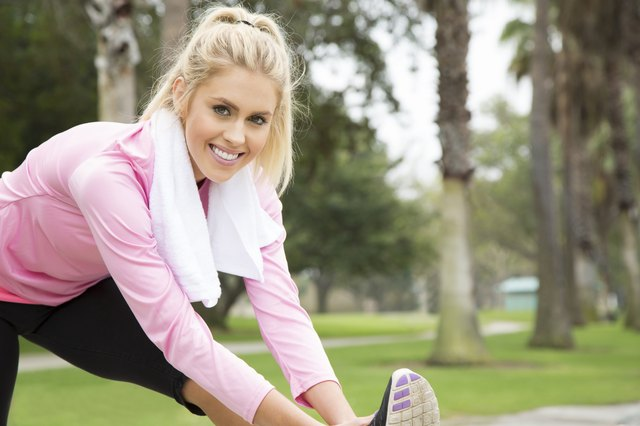 Pretty Blonde Stretching and Smiling Before a Jog