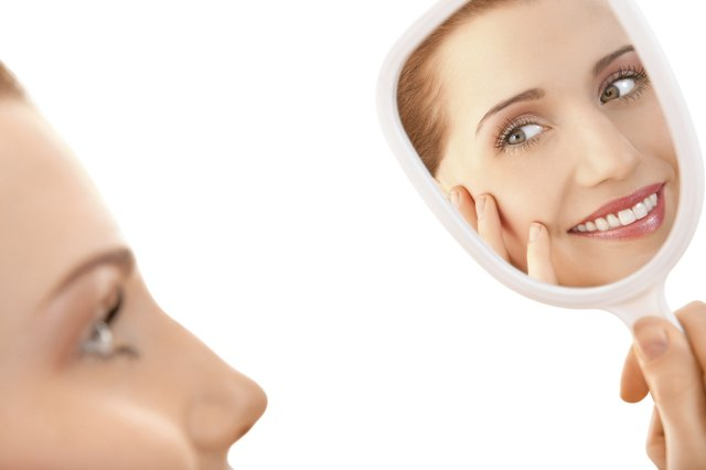 Beautiful female looking in a mirror