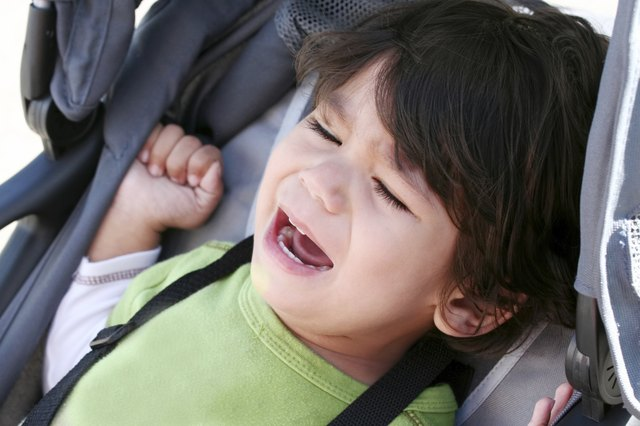 Unhappy toddler crying in stroller