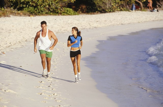 Man and woman jogging on beach