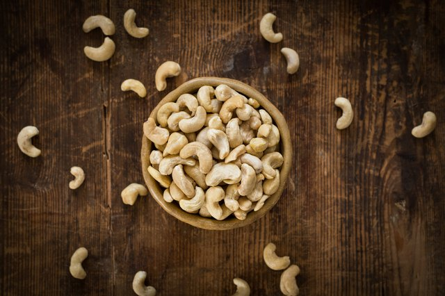 Cashew nuts in bowl, top view