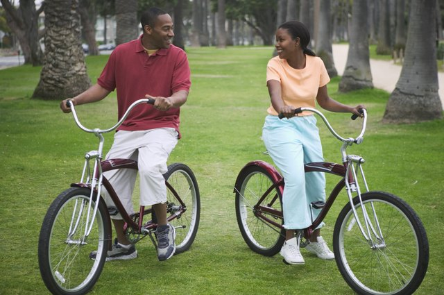 Mid adult couple sitting on bicycles