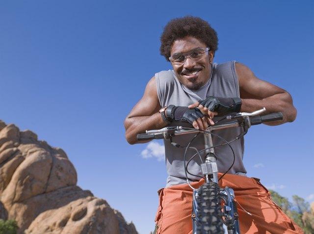 African man on mountain bike
