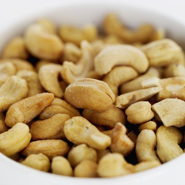 Close-up of bowl of salted cashew nuts