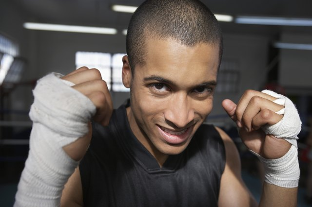 Man wearing wristbands in fighting stance, close-up