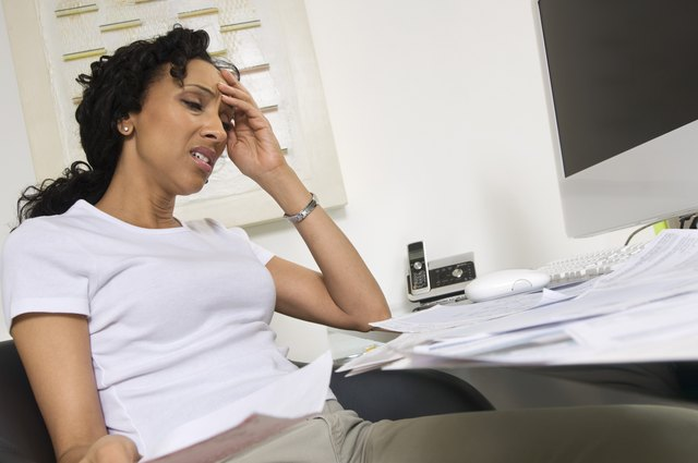 Worried Woman Doing Finances