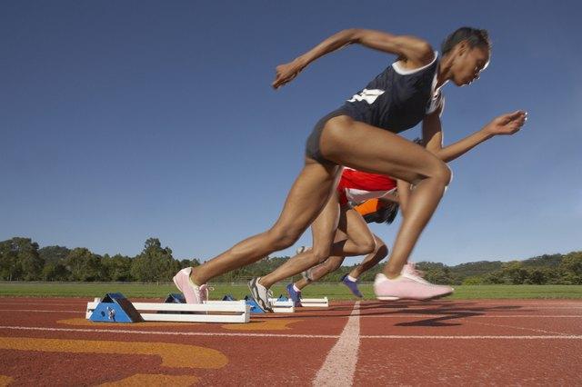 Female runners breaking from start line