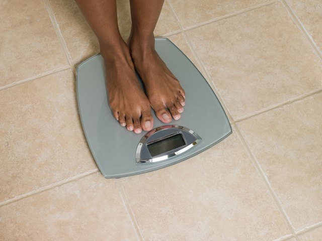 Feet of woman on scales