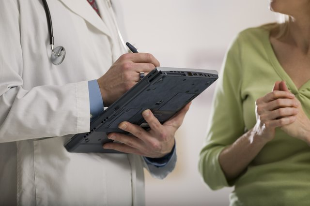 Doctor writing on tablet pc