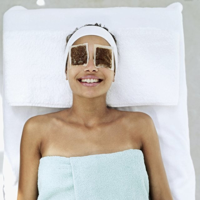 woman lying down with eye patches