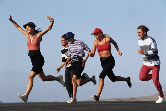Group of friends running on road