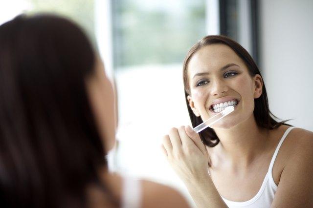 Woman brushing her teeth, close-up