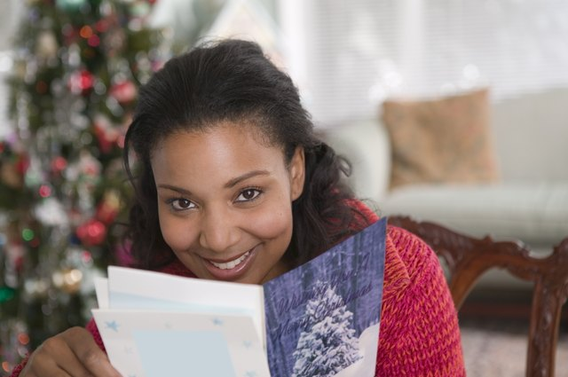 Woman reading Christmas card